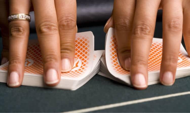 hands shuffling cards